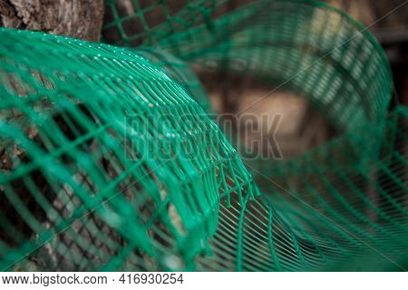 A Cargo Net Stretched Out Between Trees As Part Of An Adventure Climbing Course In The Forest,focus