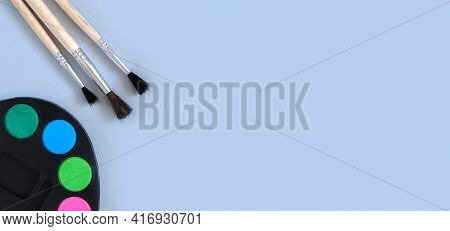 Art Palette With Paint And Paintbrushes Top View On Gray Background With Copy Space