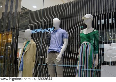 Moscow Russia - April 10 2021: Showcase Of A Store Of Fashionable Clothes And Accessories. Retail Sa