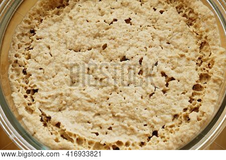 Homemade Rye Leaven Sourdough In Glass Jar Top View, Texture Close-up