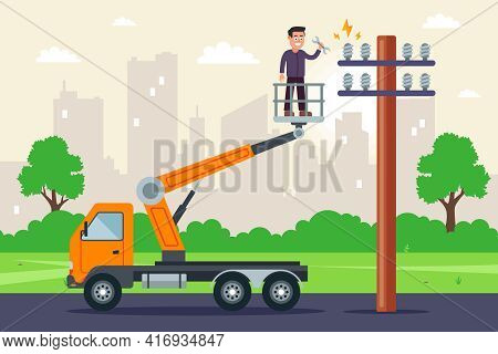 A Specialist Makes Repairs To High-voltage Wires In A Truck With A Lift. Repair Of A Pole With Elect
