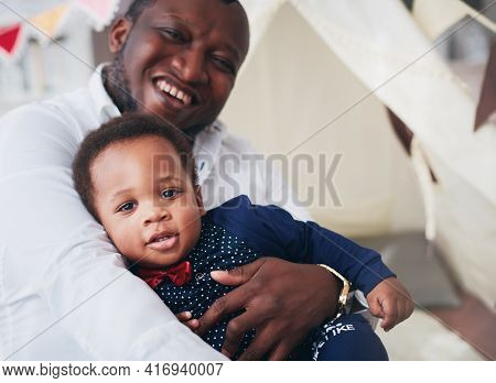 Happy Infant Baby Boy In Father's Strong Hands, Having Fun Together