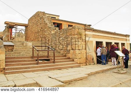 Heraklion, Knossos, Crete, Greece - October 20, 2018:  Tourists entering the Throne Room Complex in The Palace of Knosses on Crete in Greece near Heraklion is called Europe\\\\\\\'s oldest city and the ceremonial and political center of the Minoan civiliz