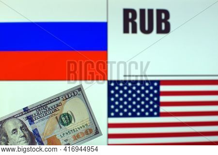 100 Us Dollars Banknote On Blurred Background Of Russian And American Flags And Russian Currency Cod