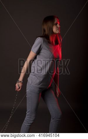 Psychological Concept Of Hard Responsibilities, Debts And Loans. Young Woman Pulling Chain With Desp