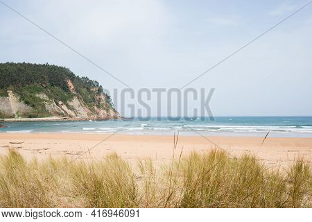 Beautiful Wiew Of Rodiles Beach With No People On A Spring Summer Day. Asturias