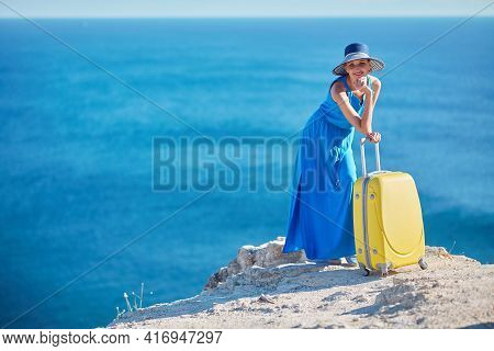 Cheerful Smiling Lady On Holiday. Ocean View And Fresh Air. Vacation Abroad Summer And Relax Time Co