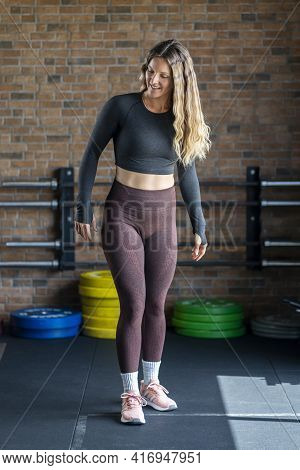 Fitness Woman At The Gym. Sporty Attractive Woman In Sportswear During Work Out