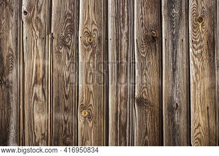 Tongue And Groove Pine Wood Wall. Dark Knotted And Weathered Look