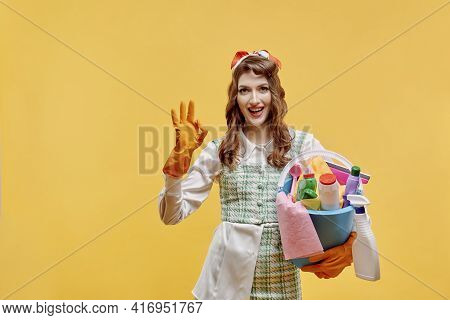 The Happy Cleaning Lady Shows The Ok Gesture And Looks At The Camera.
