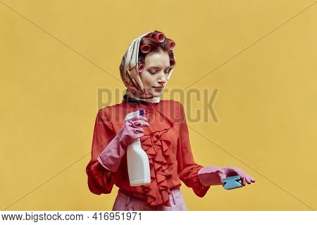The Cleaning Lady Is Holding A Window Spray And A Sponge. Yellow Background.