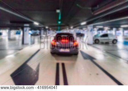 Garage Car Blurred. Car Lot Parking Space In Underground City Garage. Empty Road Asphalt Background