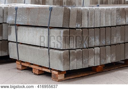 Pallet With A Stack Of Concrete Curb Stone On Construction Site. Road Repairs. Few Stacks Of Curbs P