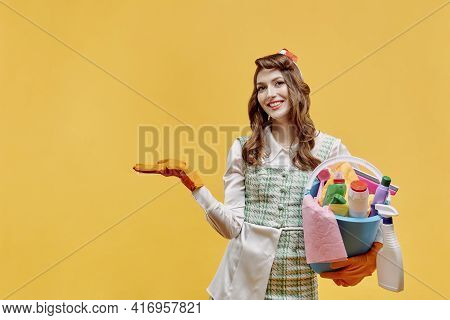 A Cleaning Lady Holds A Bucket Of Tools And Points Her Hand At A Copy Of Space.