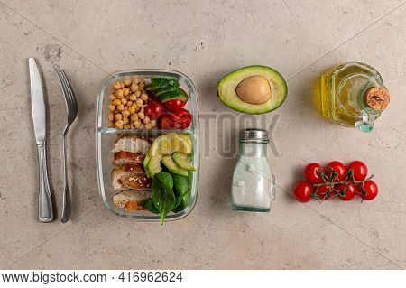 Lunch Box With Chicken, Avocado, Cucumber, Tomato And Spinach