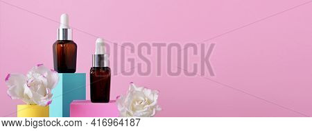 Beauty Natural Skincare Product Banner. Serum Or Collagen Dropper Bottles On Different Geometric Pod