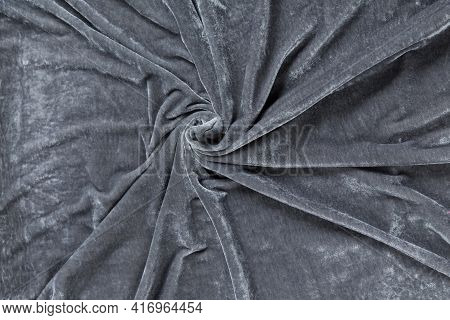Colored Grey Textile Satin Fabric Folded In Folds And Waves With Highlights And Texture Shimmers In