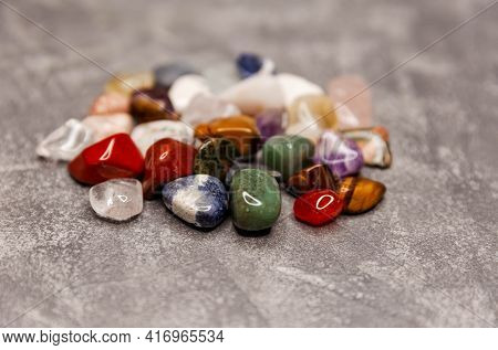 Variety Of Crystals On Textured Background. Crystal Minerals On Mysterious Nature. Healing Crystal B