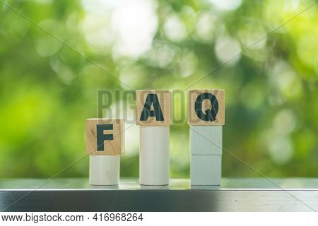 Blocks With The Word Faq (frequently Asked Questions) Against Black Background. Collection Of Freque