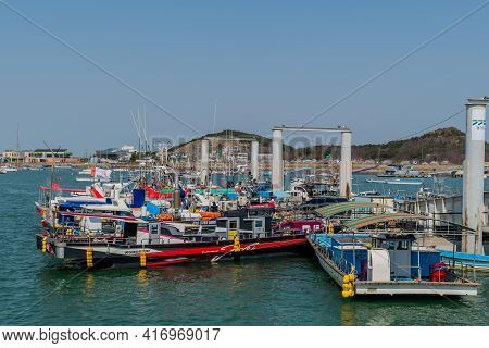 Pyeongtaek, South Korea; April 6, 2021:tour Boats And Fishing Trawlers Docked At Jeongok Marina.