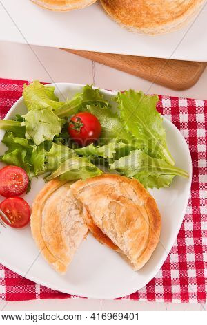 Puff Pastry Filled With Tomato And Mozzarella Cheese.