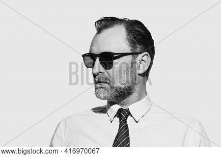 Businessman portrait in black and white. Businessman portrait in black and white technique. Portrait of businesman in black and white. Businessman portrait. Studio portrait of businessman.