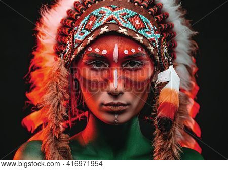 Aboriginal Woman With Painted Skin And Traditinal Indian Headwear