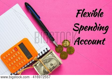Flexible Spending Account With Notebook, And Fake Money. One Of A Number Of Tax-advantage Financial