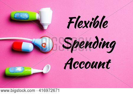 Flexible Spending Account With Medical Toy On Pink Background. One Of A Number Of Tax-advantage Fina