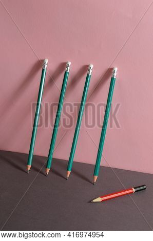 Geometric Minimalistic Composition With Wooden Pencils. New Matching Green Pencils Are Leaning Again
