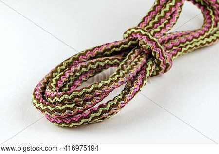 Universal Polypropylene Rope On A Neutral Background. A Coil Of New Colored Rope. Close-up. Selectiv
