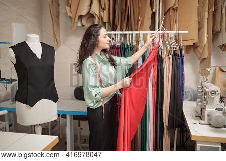 Female Fashion Designer Works On New Womenswear Collection For Clients In Cozy Workshop Studio, Dres