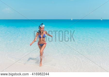 Beach vacation happy snorkeling watersport recreational activity Asian woman wearing snorkel mask for underwater swim in Caribbean island on summer travel.