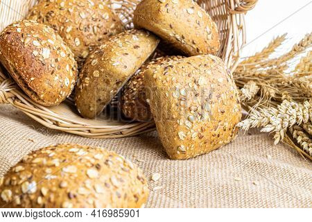 Traditional Bread. Fresh Loaf Of Rustic Traditional Bread With Wheat Grain Ear Or Spike Plant On Lin