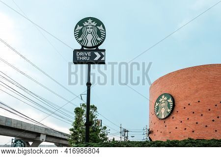 Ayutthaya, Thailand - April 14, 2021: Drive Thru Sign Of Starbuck Coffee Shop. It Is An Us Global Co