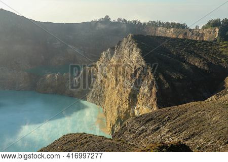 Spectacular View Of Blue And Turquoise Lakes On Kelimutu Volcano, Famous National Park On Flores Isl