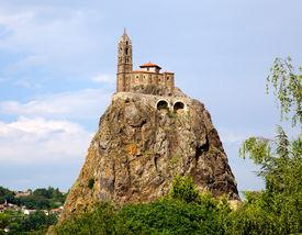 Ancient Chapelle Saint Michel De Aiguilhe Standing At A Very Steep Volcanic Needle (le Puy En Velay,