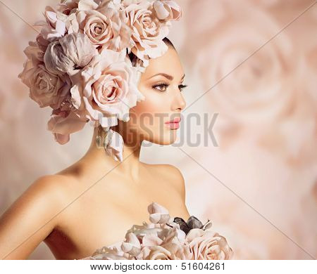 Fashion Beauty Model Girl with Flowers in her Hair. Bride. Perfect Creative Make up and Hair Style. Bouquet of Beautiful Flowers. Floral Hairstyle