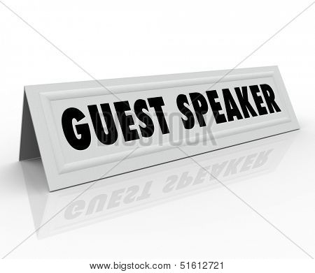 The words Guest Speaker on a paper folded tent card to illustrate the name of the person who will speak at a conference, meeting or panel discussion