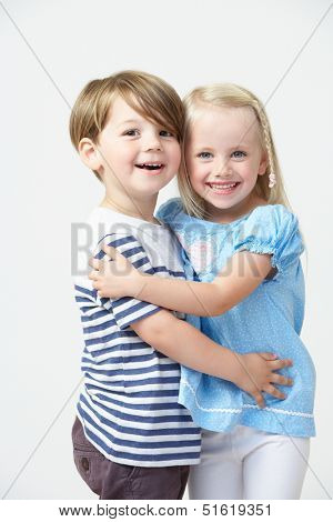 Two Pre School Pupils Hugging One Another