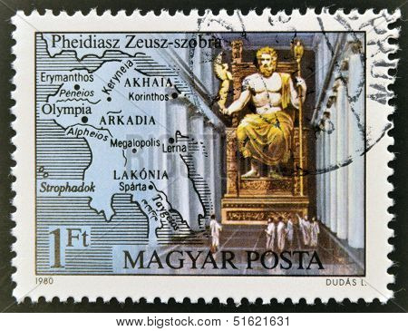 A stamp printed in Hungary shows sculpture of Zeus and Map of Greece