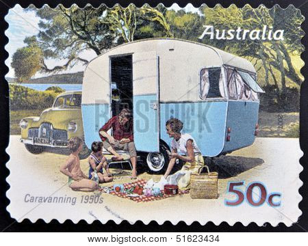 A stamp printed in australia shows Family enjoying a caravan of the 50s caravanning 1950s