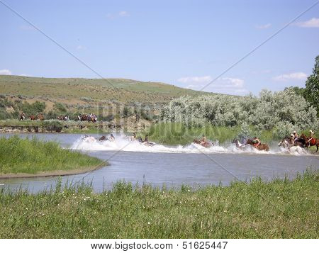 Bareback Indians Rush Into River