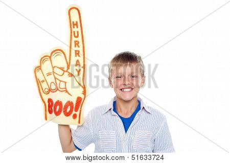 Boy With A Hurray Boo Foam Hand. Young Fan