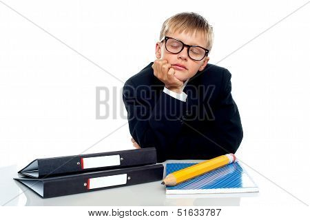 School Boy In Glasses Dozing Off
