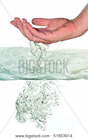 First Plane Of Woman's Hand Leaving The Water
