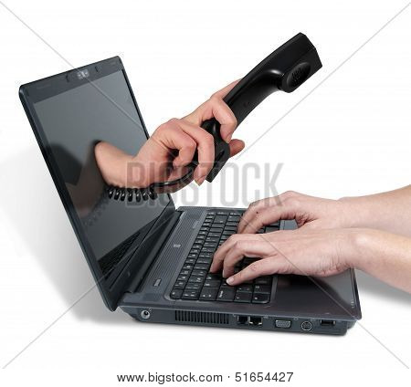 Woman's Hands Writing In Computer And Telephone