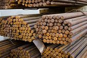 Rust Reinforce steel rod or bars in warehouse. Industrial poster