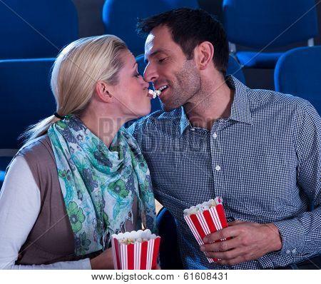 Loving Couple Sharing Their Popcorn