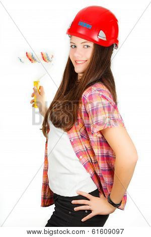 girl in a building helmet with a painter roller in a hand